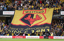 """Watford fans display a large flag during the Premier League match at Vicarage Road, Watford PRESS ASSOCIATION Photo. Picture date: Saturday September 15, 2018. See PA story SOCCER Watford. Photo credit should read: Nigel French/PA Wire. RESTRICTIONS: EDITORIAL USE ONLY No use with unauthorised audio, video, data, fixture lists, club/league logos or """"live"""" services. Online in-match use limited to 120 images, no video emulation. No use in betting, games or single club/league/player publications."""