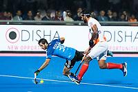 BHUBANESWAR -  Hockey World League finals , Semi Final . Argentina v India. Agustin Bugallo (Arg) met Rupinder Pal Singh (Ind) .  COPYRIGHT KOEN SUYK