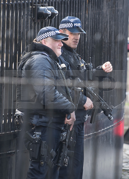 © Licensed to London News Pictures. 22/03/2018. London, UK. Armed police guard Carriage Gate at the Houses of Parliament in Westminster, London on the one year anniversary of the Westminster Bridge Terror attack in which lone terrorist killed 5 people and injured several more, in an attack using a car and a knife. The attacker, 52-year-old Briton Khalid Masood, managed to gain entry to the grounds of the Houses of Parliament and killed police officer Keith Palmer. Photo credit: Ben Cawthra/LNP