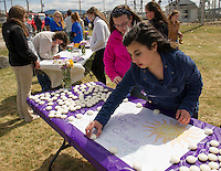 Kaitlyn Mowery and Yzabelle Mitchell line candles around the table for Lily Johnson for the memorial gathering along Lake Opechee Saturday afternoon.  (Karen Bobotas/for the Laconia Daily Sun)