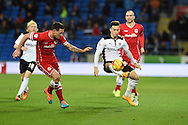 Tom Lawrence of Rotherham Utd © looks to go past Cardiff's Sean Morrison (l). Skybet football league championship match, Cardiff city v Rotherham Utd at the Cardiff city stadium in Cardiff, South Wales on Saturday 6th December 2014<br /> pic by Andrew Orchard, Andrew Orchard sports photography.