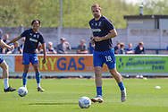 AFC Wimbledon striker James Hanson (18) and AFC Wimbledon defender Toby Sibbick (20) warming up during the EFL Sky Bet League 1 match between AFC Wimbledon and Bristol Rovers at the Cherry Red Records Stadium, Kingston, England on 19 April 2019.