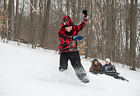 """Brytin took a ride down the sliding hill at Memorial Park in Laconia during Tuesday's """"snow day"""".  (Karen Bobotas Photo/for The Laconia Daily Sun)"""