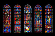 Medieval Window of the South Transept of the Gothic Cathedral of Chartres, France- Circa 1225-30. A UNESCO World Heritage Site. These windows were a donation of the Mauclerc family, the Counts of Dreux-Bretagne, who are depicted with their arms in the bases of the lancets above (centre) is the Virgin Mary & Child and on either side are the four evangelists sitting on the shoulders of four Prophets - a rare literal illustration of the theological principle that the New Testament builds upon the Old Testament. .<br /> <br /> Visit our MEDIEVAL ART PHOTO COLLECTIONS for more   photos  to download or buy as prints https://funkystock.photoshelter.com/gallery-collection/Medieval-Middle-Ages-Art-Artefacts-Antiquities-Pictures-Images-of/C0000YpKXiAHnG2k