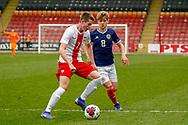 Jakub Kaminski shields the ball from Michael Craig (Tottenham Hotspur) during the U17 European Championships match between Scotland and Poland at Firhill Stadium, Maryhill, Scotland on 26 March 2019.