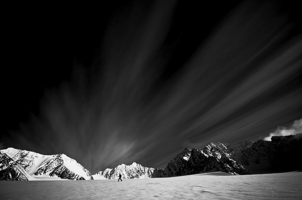 Jeremy Jones, splitboarding the glacier traverse from camp, Svalbard.
