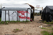 France. Refugees. Calais. So-called Jungle camp . Words painted on a shelter saying 'Darfur is bleeding' and a picture of a camel.