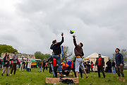 Residents of Napier Barracks and locals play volleyball together as 200 campaigners from different local groups came together today for a festival of solidarity with residents of Napier Barracks, a former military barracks that is being used as an assessment and dispersal facility for asylum seekers by the Home Office on the 21st of May 2021 in Folkestone, Kent, United Kingdom. (photo by Andrew Aitchison / In Pictures via Getty Images)
