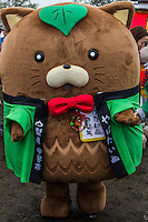Yahatainu Mascot - Japanese celebrate the silly, eccentric and adorable like no other country.  Its obsession with the yuru-kyara mascots is a perfect example of this.  These mascots represent products, teams, museums, schools, branches of the military, organizations  and even the national tax office.   Most towns, counties, and companies have their own yuru-kyara mascot, following this craze.  Creepy or cute, they lurk around street fairs, community events, train stations and tourist destinations.  There are large Mascot Summits such as the one in Hanyu, Saitama held every year where mascots campaign and are voted on.  Mascots normally represent local culture or products. They may be created by local government or other organizations to stimulate tourism and economic development, or created by a company to build on their corporate identity. They may appear as costumed lovable characters at promotional events and festivals meant to convey affection for one's hometown or region. Japanese celebrate the silly, eccentric and adorable like no other country.  Its obsession with the yuru-kyara mascots is a perfect example of this.  These mascots represent products, teams, museums, schools, prisons, branches of the military, organizations  and even the national tax office.   Most towns, counties, and companies have their own yuru-kyara mascot, following this craze. Creepy or cute, they lurk around street fairs, community events, train stations and tourist destinations.  There are large Mascot Summits such as the one in Hanyu, Saitama held every year where mascots campaign and are voted on.  Mascots normally represent local culture or products. They may be created by local government or other organizations to stimulate tourism and economic development, or created by a company to build on their corporate identity. They may appear as costumed lovable characters at promotional events and festivals meant to convey affection for one's hometown or region.