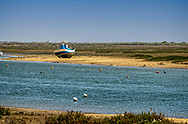 The ship, Nunes Tavira, grounded during low tide on the Gilåo river.