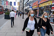 As the national coronavirus lockdown three eases towards the planned Freedom Day in just over two weeks, people, many of whom are still wearing face masks while out on the street, come to Oxford Street shopping district on 3rd July 2021 in London, United Kingdom. Now that the roadmap for coming out of the national lockdown and easing of restrictions is set, dome medical professionals are suggesting thatsome safety measures are kept in place because of the increase in the Delta variant.