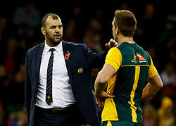 Head Coach Michael Cheika of Australia with Dane Haylett-Petty during the pre match warm up<br /> <br /> Photographer Simon King/Replay Images<br /> <br /> Under Armour Series - Wales v Australia - Saturday 10th November 2018 - Principality Stadium - Cardiff<br /> <br /> World Copyright © Replay Images . All rights reserved. info@replayimages.co.uk - http://replayimages.co.uk