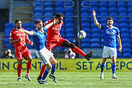 Nottingham Forest's Sammy Ameobi (11) tussles with Cardiff City's Joe Ralls (8) during the EFL Sky Bet Championship match between Cardiff City and Nottingham Forest at the Cardiff City Stadium, Cardiff, Wales on 2 April 2021.
