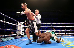 Rasheed Abolaji (right) holds onto Felix Cash's foot during the vacant commonwealth middleweight championship contest at The O2 Arena, London.