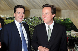 Left to right, GEORGE OSBORNE MP and DAVID CAMERON MP  at the Spectator Summer Party held at 22 Old Queen Street, London SW1 on 3rd July 2008.<br /><br />NON EXCLUSIVE - WORLD RIGHTS