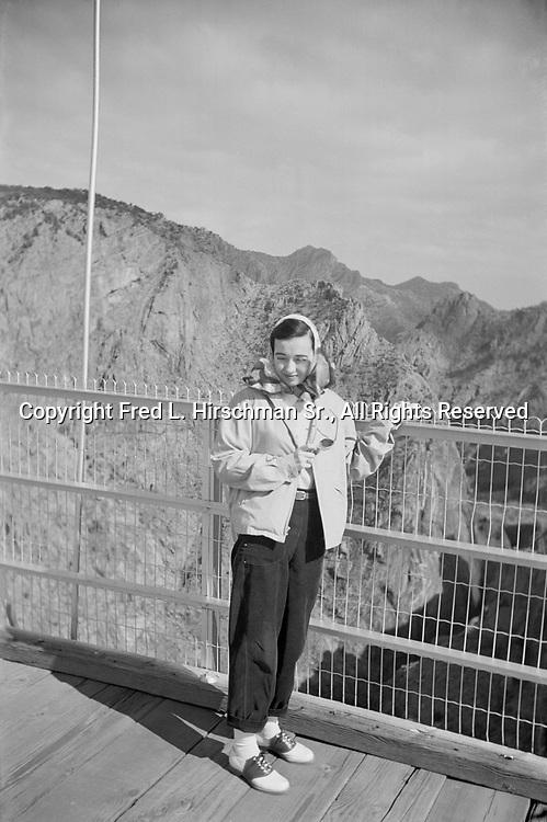 Octavia Hirschman above the Arkansas River and walking across the Royal Gorge Bridge, Colorado, September 1949