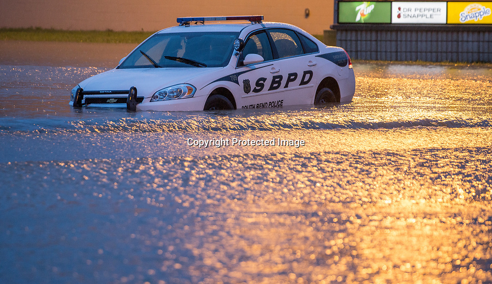 Torrential rains flooded parts of South Bend and closed many streets on Tuesday August 16, 2016. A South Bend police car sits disabled on Burnett Drive in South Bend. Tribune Photo/SANTIAGO FLORES