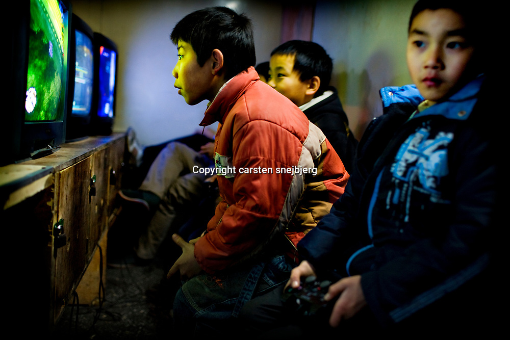 Boys having fun with playstations downtown in Chongqing, China, on friday 25. jan, 2008