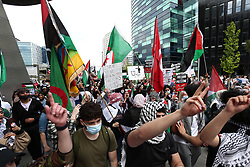 © Licensed to London News Pictures. 29/05/2021. Salford, UK.  Protesters march at a 'Protest for Palestine' outside the BBC studios in Media City. Pro-Palestine demonstrations have been taking place worldwide in the wake of Israel's 11 day bombardment of Gaza which resulted in hundreds of civilian deaths. Photo credit: Adam Vaughan/LNP