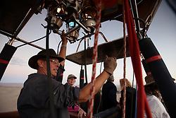NAMIBIA SOSSUSVLEI 21APR14 - Pilot Eric Hesemans steers his balloon during a flight with Namib Sky Balloon Safaris in Sossusvlei, Namib Desert, Namibia.<br /> <br /> jre/Photo by Jiri Rezac<br /> <br /> © Jiri Rezac 2014