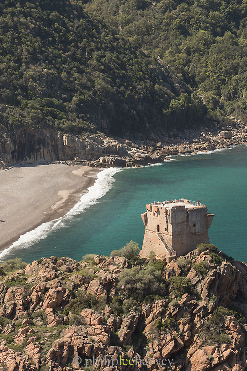High angle view of beach and tower on rocks, Porto Marina, Corsica, France