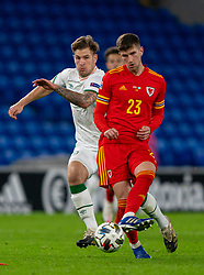 CARDIFF, WALES - Sunday, November 15, 2020: Wales' Chris Mepham (R) and Republic of Ireland's James Collins during the UEFA Nations League Group Stage League B Group 4 match between Wales and Republic of Ireland at the Cardiff City Stadium. Wales won 1-0. (Pic by David Rawcliffe/Propaganda)
