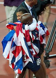 © Licensed to London News Pictures. 06/06/2012. London,Britain. Mo Farah celebrates with his daughter Rihanna after winning the gold medal in the Men's 10000m, at the Olympic Stadium, in London, during the London 2012 Olympic Games.  Photo credit : Bogdan Maran/LNP/BPA