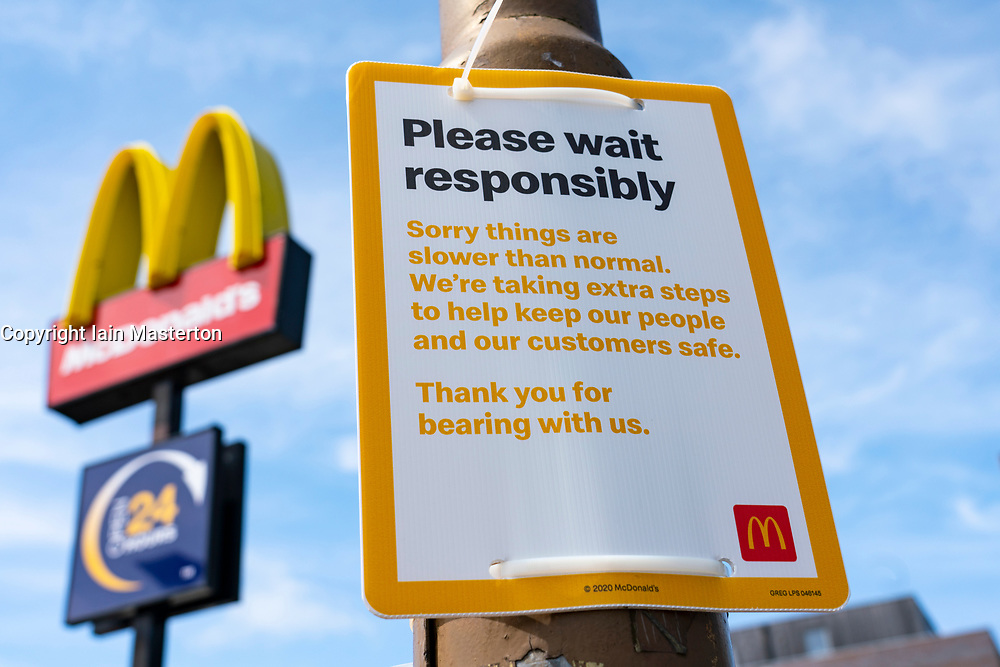 Edinburgh, Scotland, UK. 11 June 2020. Sign outside McDonalds drive-thru restaurant in Edinburgh warning about slow service times during Covid-19 re-opening of restaurants during lockdown relaxation. Iain Masterton/Alamy Live News
