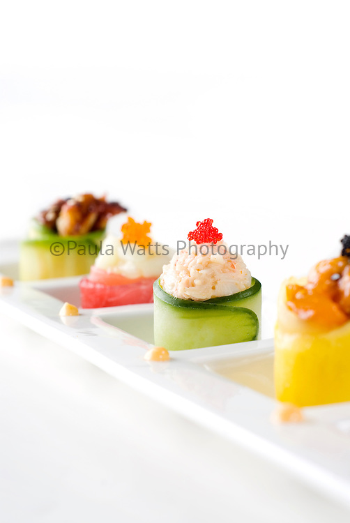 Cucumber and crab sushi roll at Japanese Restaurant on white background