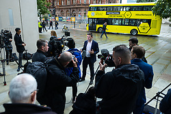 """© Licensed to London News Pictures . 02/10/2021. Manchester, UK. On the eve of the Conservative Party Conference, Greater Manchester Metro Mayor ANDY BURNHAM (pictured talking to media), Bolton Council Leader Martyn Cox and Local Enterprise Partnership Chair Lou Cordwell launch a campaign for an integrated public transport service for Manchester , along the lines of that available in London. The """" Destination: Bee Network """" would integrate bus, tram and bicycle networks and reduce the cost of fares as part of what is described as a Levelling Up Deal . The Conservative Party Conference takes place at the Manchester Central Exhibition Centre from tomorrow (3rd October 2021). Photo credit: Joel Goodman/LNP"""