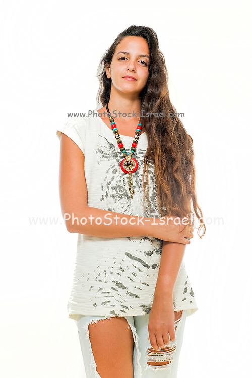 Young spiritual woman in her 20s with long brown hair in casual dress. Model release available