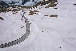THEMENBILD - ein gelber Audi R8 Sportwagen auf der Strasse umringt vom Schnee . Die Hochalpenstrasse verbindet die beiden Bundeslaender Salzburg und Kaernten und ist als Erlebnisstrasse vorrangig von touristischer Bedeutung, aufgenommen am 11. Juni 2020 in 11. Juni 2020 in Heiligenblut, Österreich // a yellow Audi R8 sports car on the road surrounded by snow. The High Alpine Road connects the two provinces of Salzburg and Carinthia and is as an adventure road priority of tourist interest, Heiligenblut, Austria on 2020/06/11. EXPA Pictures © 2020, PhotoCredit: EXPA/ JFK