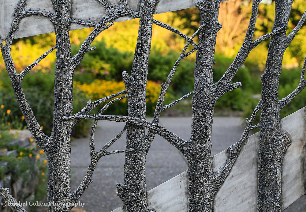 """""""Through the Garden Gate""""<br /> <br /> Beautiful metal gate shaped like trees lets you gaze into the botanical garden beyond!!<br /> <br /> Flowers and Wildflower by Rachel Cohen"""