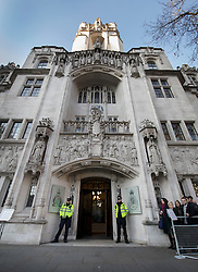 © Licensed to London News Pictures. 05/12/2016. London, UK. Police stand outside the Supreme Court in Westminster, London for the first day of a Supreme Court hearing to appeal against a November 3 High Court ruling that Article 50 cannot be triggered without a vote in Parliament. Photo credit: Peter Macdiarmid/LNP