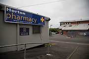 Pharmacy in a prefabricated building in Highgate, Birmingham, United Kingdom. Following the Big City Plan of February 2008, Highgate is now a district of Birmingham City Centre, yet is a very poor area which lacks general upkeep, investment and with boarded up buildings, is a mainly desolate area.