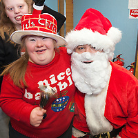 Claire Fitzgerald meets Santa on his visit to St Clares School on Friday