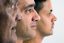 Side view portrait of three generations of a family; grandfather; father and son,