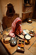 INDIA, RAJASTHAN Rajasthani woman in the family kitchen,  in Jailalmer, Rajasthan