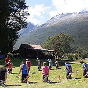 Competitors take part in a stretch class after competing in the Paradise Triathlon and Duathlon series, Paradise, Glenorchy, South Island, New Zealand. 18th February 2012. Photo Tim Clayton