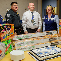 Vickie McIntyre, right, and Antonio Garcia, left, of Walmart pose with Gallup Police officers Douglas Hoffman and Steven Collins with a donation of cake and snacks that Walmart gifted to the Gallup Police in honor of Law Enforcement Appreciation Day Tuesday in Gallup. Walmart made similar gifts to local State Police and McKinley County Sheriffs offices.