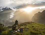Tourist setting up camp above the Passu glacier, Karakoram mountains, upper Hunza.