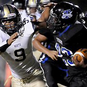 Trask's Steven Jordan is chased down by North Brunswick's Miguel Cano Friday August 29, 2014. (Jason A. Frizzelle)