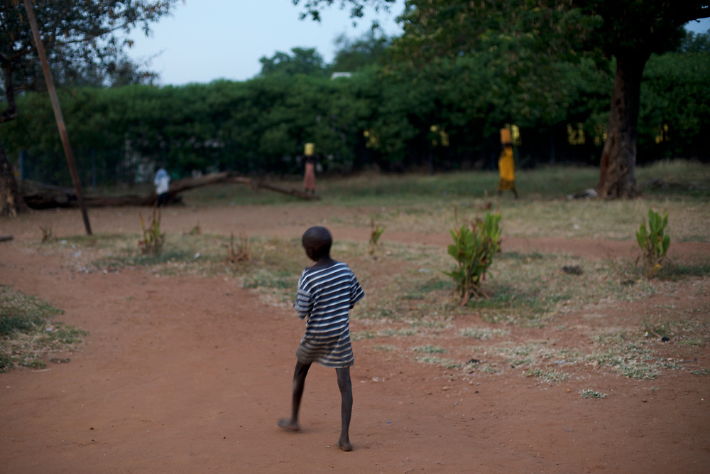 A orphan child walks by the main yard of the Orphanage Home of Juba, a shelter build for children who lost their parents during the war.