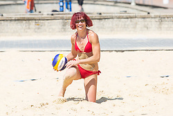 © Licensed to London News Pictures. 28/05/2018. Brighton, UK. Members of the Beach Volleyball Club from Brighton and Hove take advantage of the hot and sunny weather to play a game on the beach volleyball court on the last day of the Bank Holiday Weekend. Today, Monday May 28th 2018 is predicted to be the hottest day of the year so far. Photo credit: Hugo Michiels/LNP