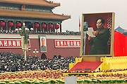 A float carrying a portrait of China's leader Mao Zedong, is marched through Tiananmen Square as China celebrates its 50th anniversary with a massive parade in Beijing October 1, 1999.
