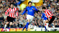 Photo. Aidan Ellis<br />Everton v Southampton. FA Barclaycard Premiership 22/02/03.<br />Everton Li Tie and Southampton Matt Oakley and Paul Telfer<br />.