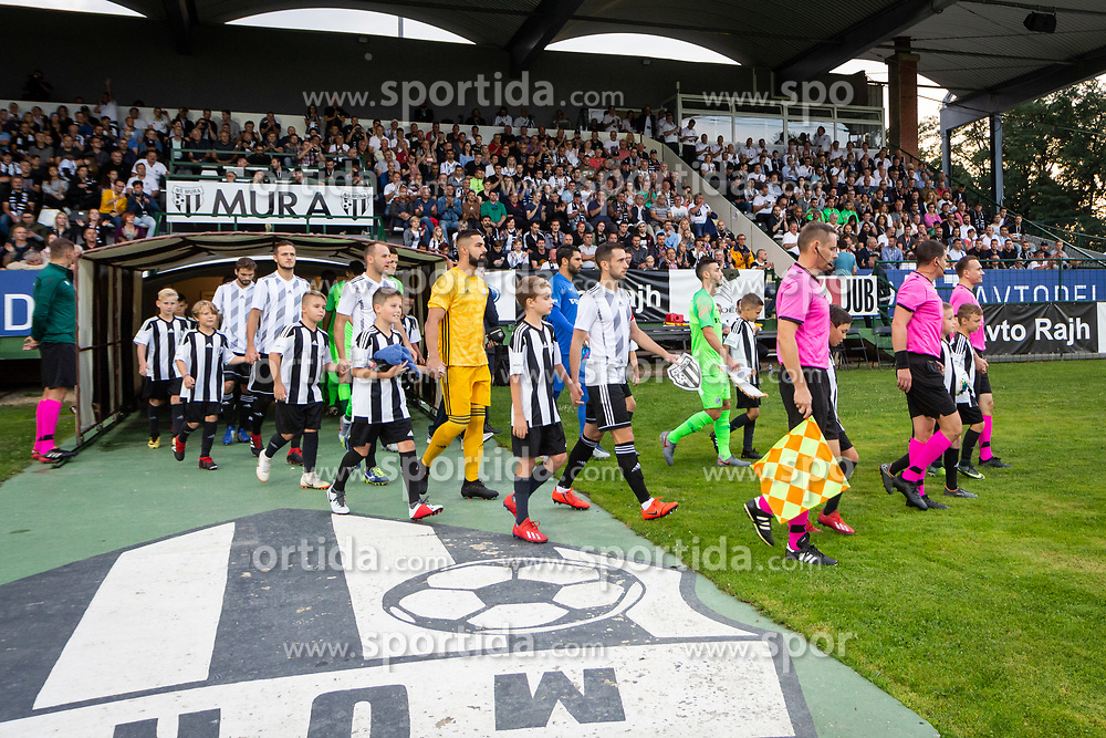 Players of bothe teams entering the pitch before Football match between NS Mura (SLO) and Maccabi Haifa (IZR) in First qualifying round of UEFA Europa League 2019/20, on July 18, 2019, in Stadium Fazanerija, Murska Sobota, Slovenia. Photo by Blaž Weindorfer / Sportida