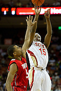 Ben Emelogu (15) of South Grand Prairie shoots over Andrew Harrison (5) of Fort Bend Travis during the UIL 5A state championship game at the Frank Erwin Center in Austin on Saturday, March 9, 2013. (Cooper Neill/The Dallas Morning News)