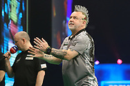 Peter Wright reacts to missing a shot at a double during the PDC Unibet Premier League darts at Marshall Arena, Milton Keynes, United Kingdom on 27 May 2021.