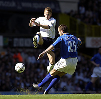 Copyright Sportsbeat. 0208 3926656<br />Picture: Henry Browne<br />Date: 05/04/2003<br />Tottenham Hotspur v Birmingham City FA Barclaycard Premiership<br />Teddy Sheringham of Spurs tries to block a clearance from Matthew Upson of City